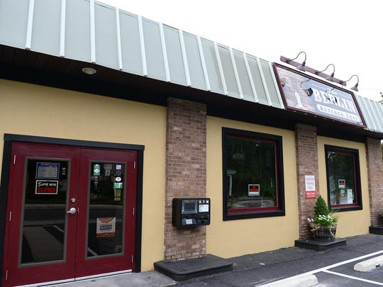 """The Berlin Butcher Shop owned by Lisa Hall, now has """"sorry we are closed"""" and """"no trespassing signs"""" posted in the stores windows on Monday, Sept. 12, 2017."""