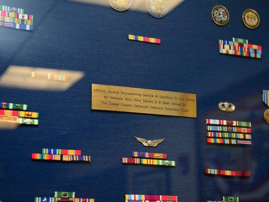 A shadow box displays the ribbons earned by veterans