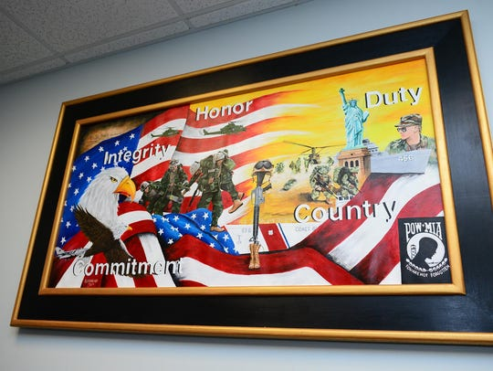 A donated painting by an incarcerated veteran is displayed