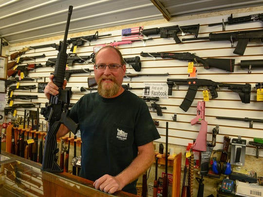 Bob Arthur, Owner of Arthur's Shooters Supply, displays an example of a Maryland Compliant heavy barrel AR15 complete with a bump stock on Thursday, Oct 5, 2017 in Berlin, Md.
