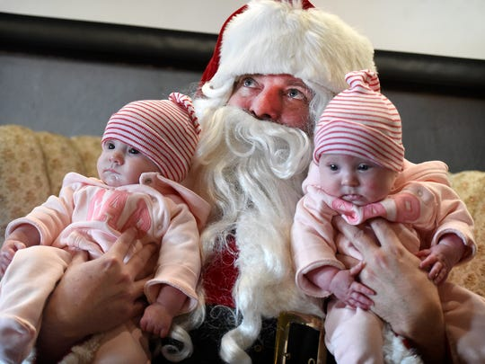 Four-month-old twins Reese and Piper Bulloch get their