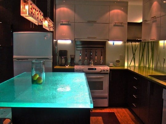Granite and quartz are still in style, but glass is a newer option, as in this Winsome glass countertop.