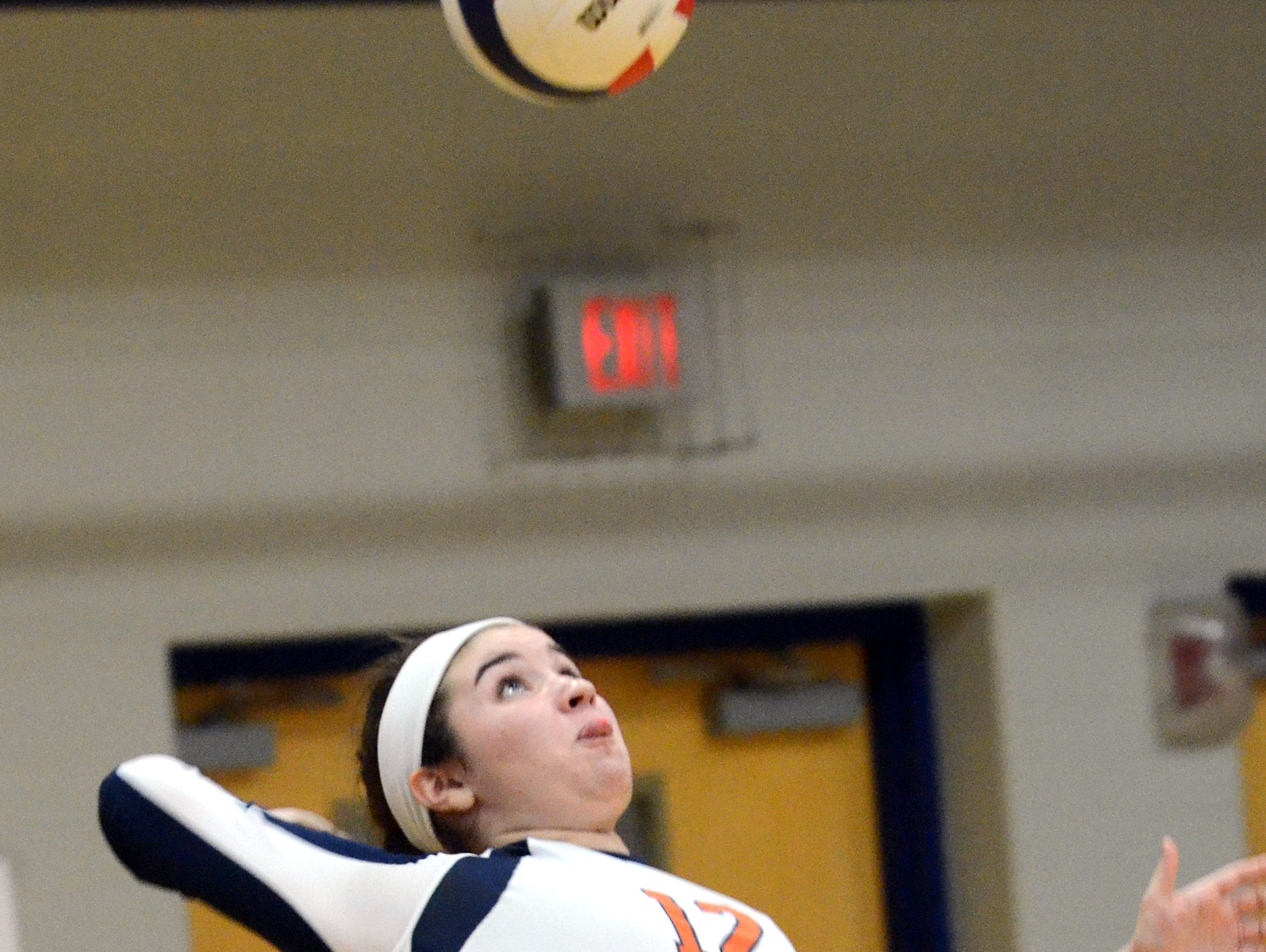 Beech High junior Reeves Parrish swings into a jump-serve during the second game.