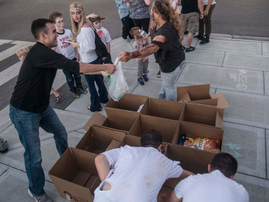 Donations were accepted for the Montgomery Area Food Bank. Downtown Montgomery's streets were filled with the living dead on Friday, Sept. 30, 2016, for the Zombie Walk & Prom VI.