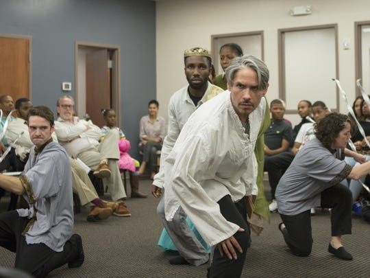 """Trevor Fayle (Lysimachus), from left, Jamal Douglas (Pericles), Danielle Leneé (Helicanus, in background), J Hernandez (Cleon), Corinna Burns (Dionyza) perform at the Achievement Center of the Wilmington HOPE Commission in the Delaware Shakespeare Festival's touring production of """"Pericles."""""""