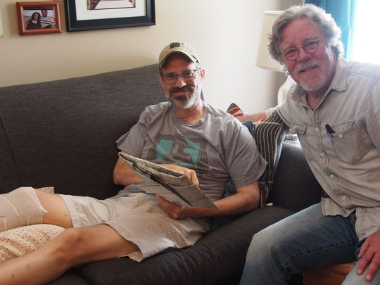 David Brill, right, visits Michael Aday following the
