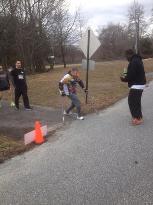 Matt Rich, a 32-year-old with cerebral palsy, rounds a corner on the Police Unity Tour 5K course on March 15, 2015.