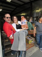Conrad and Maria Krinock at a food distribution event.