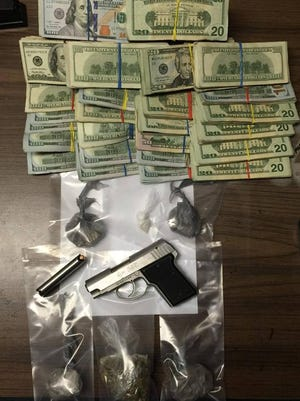 A Wayne County Drug Task Force investigation uncovered heroin, marijuana, a loaded handgun and more than $28,000 cash Tuesday.