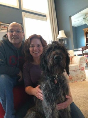 Matt and Penny Davis with their dog, Happy, in December 2014, just before neurological problems began for Matt.