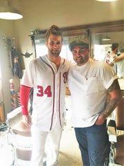 Bryce Harper shot an MLB commercial at Alfie's Barber Shop in Melbourne, Florida. Shown is Alfie Silva, barbershop owner.