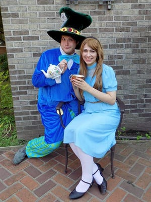 """Matt Gaska is the Mad Hatter and Kimberly Geniece is Alice at """"Alice in Wonderland: A Princess Tea Party."""""""