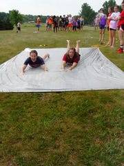Becca Hasler (right), a Camp Kesem counselor, participates