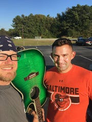 Dover Police Department Det. Matt Knight (right) meets with Dave Nickolson to return his guitar while off-duty.
