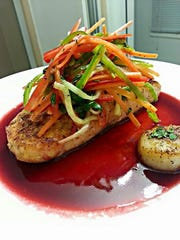 Chris Burnett's salmon and scallops with veggie slaw and beet juice reduction.