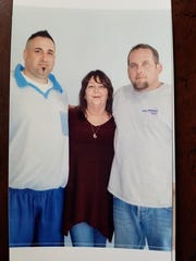Brenda Stewart got a picture taken with her sons Richard, left, and Jeremy during a recent prison visit with Richard.