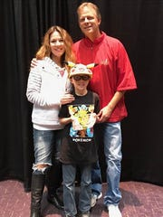 Pokemon Trading Card Game champ Regan Retzloff and his parents, Steve Retzloff and Melissa Arterberry