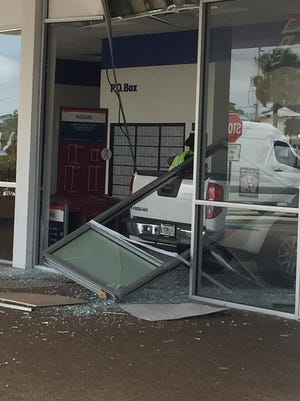 A pickup crashed into a post office in Titusville Friday.