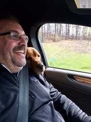 Detroit Pistons coach Stan Van Gundy with his new dog, Eastwood, on May 9, 2017.