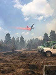 Retardant is dropped on the Ditch Creek fire in Smith River country in Meagher County.