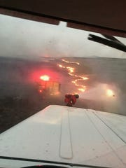 Local volunteer firefighters work on putting out the