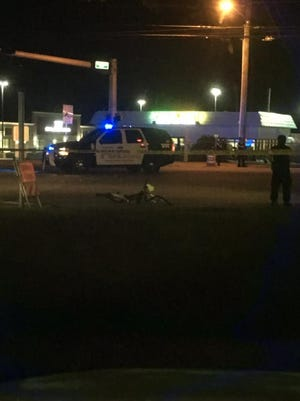 Police investigate the scene of a crash at North Ninth Avenue and Creighton Road in Pensacola. A 54-year-old bicyclist was killed in the wreck.