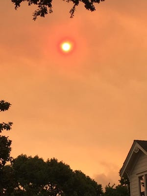 Haze from wildfire smoke tints the sun and sky in Sonoma, California on Monday, Oct. 9.