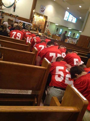 In 2013, members of the Port Clinton's eighth grade football team attend the funeral of teammate Devin Kohlman.