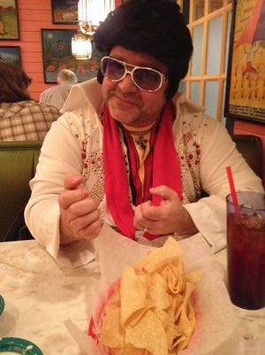 A Chuy's customer dresses up like Elvis for the restaurant's annual Elvis Birthday Bash.