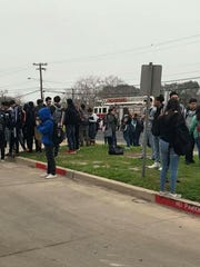 Students of Carroll High School stand outside after