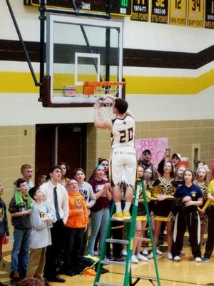 Jacob Webb cuts his loop from the net to celebrate Old Fort's share of the Sandusky Bay Conference River Division crown.