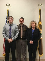 Sheriff Jeff Cappa (center) stands with recently promoted