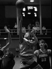 Holy Cross' Christi Hester attempts a shot against Holy Rosary. Jan 20, 1996.