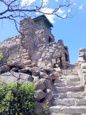 While surrounding vegetation and wood finishings were badly burned in the Little Bear Fire, the stone structure of Monjeau Lookout still gives a good vantage point for spotting fires
