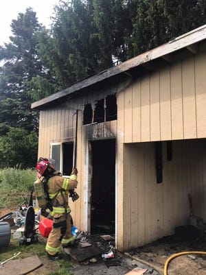 Firefighters with Marion County Fire District #1 and Salem Fire Department are investigating the cause of a carport fire on the  4200 block of Silverton Rd NE in Salem on Tuesday, May 29, 2018.