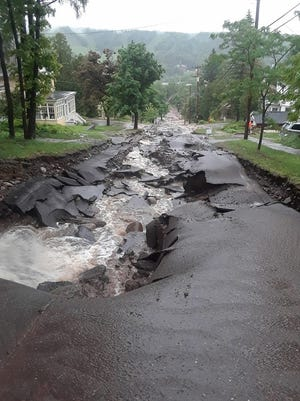 Flood waters damaged Agate Street in Houghton.
