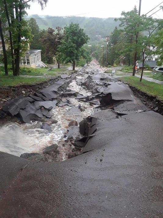 636648659275215698-Street-damage.jpg