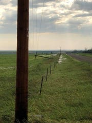Straight-line winds snapped power poles in the Froid area.