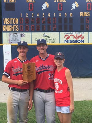 Nolan, Andy and Heather Cook pose with Funkhouser's American Legion Championship trophy after beating Princeton 6-4 on Sunday.