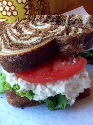 Acorn Market is know for its sandwiches, especially the chicken salad sandwich. This famous dish is made with mayonnaise, honey and salt and pepper and is served on a fresh roll.