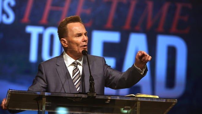 Pastor Ronnie Floyd gives the presidential address to the Southern Baptist Convention at the Greater Columbus Convention Center, in Columbus, Ohio, on Tuesday. Floyd exhorted members to stand united against same-sex marriage and vows that he will never officiate a same-sex union.