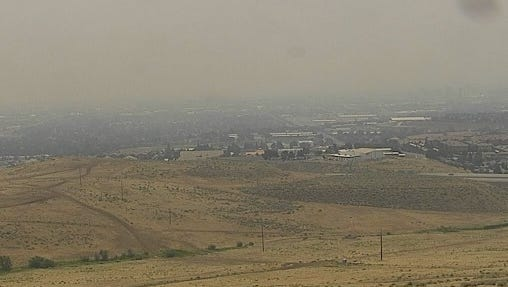 Smoke blankets Reno at 1:02 p.m. Monday, July 30, 2018 as seen from a webcam at the NOAA weather station.