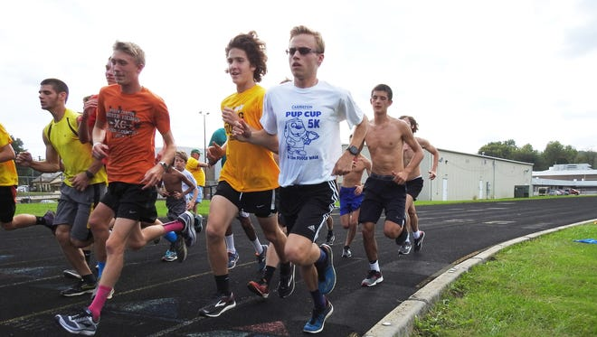 Tri-Valley senior Caden Sauerbrey (white) runs during practice, as the Scotties prepare for the Muskingum Valley League Cross Country meet. Sauerbrey is among the favorites in the boys race with Sheridan's Luke Brown and defending champion, John Glenn's Dylan Curtis.