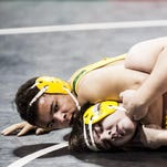 CMR's Noah Danielson controls Helena Capital's Carson Shuman during the Class AA State quarterfinals in the Billings MetraPark Friday.