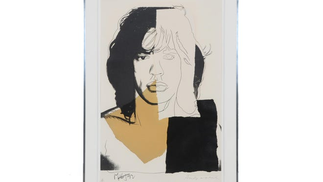 This limited edition silkscreen by Andy Warhol is signed by the artist and Mick Jagger. It sold for $34,869 on Everything But the House.