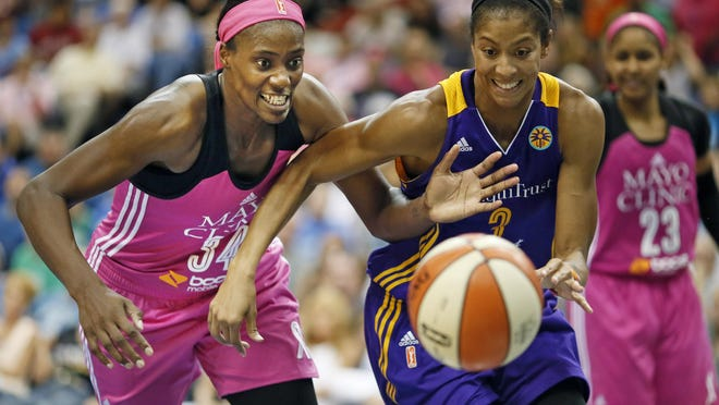 The Minnesota Lynx's Sylvia Fowlers, left, tries to steal the ball from Los Angeles Sparks' Candace Parker in the second half of an Aug. 9, 2015, game in Minneapolis. The Minnesota Lynx and Los Angeles Sparks open the best-of-five WNBA Finals on Sunday.