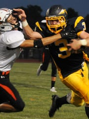 Elco's Kyle Knight tries to fight off the tackle of
