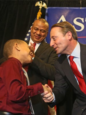 Rob Astorino shakes the hand of the son of his running mate Christopher Moss after giving his concession speech at the Crowne Plaza Hotel in White Plains Nov. 4, 2014.  Election results showed him losing to Gov. Andrew Cuomo in the race for New York Governor Nov. 4, 2014.