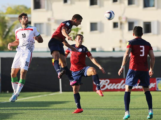 Guam's Marcus Lopez leaps for a header against I.R.