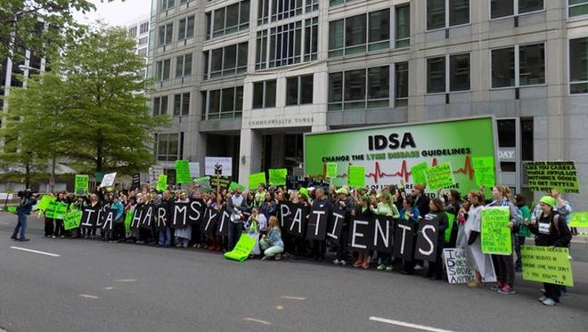 Advocates for patients protested Lyme disease treatment guidelines April 30 and May 1 outside the headquarters of the Infectious Diseases Society of America headquarters in Arlington, Virginia. The IDSA and two other medical societies are rewriting controversial guidelines for care.